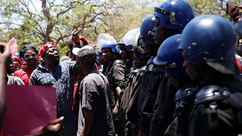 Anti-riot police blocked public sector workers from marching to government offices on November 6 with a petition demanding better pay in Harare. Despite hyperinflation, wages in Zimbabwe have remained stagnant [File: Philimon Bulawayo/Reuters]