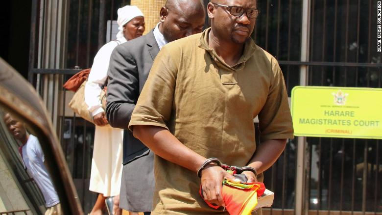 Zimbabwean pastor and activist Evan Mawarire clutches his Bible after being arrested and sent to Harare's Magistrates Court.