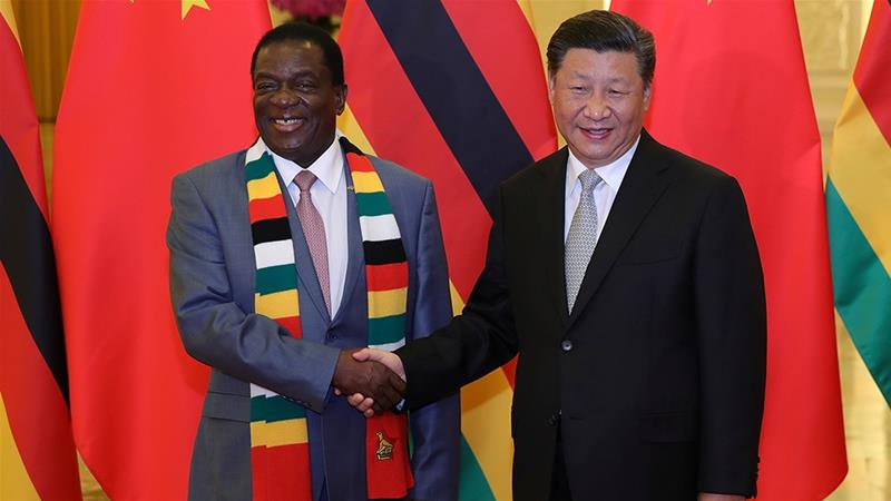 Chinese President Xi Jinping with Zimbabwe's President Emmerson Mnangagwa in 2018 [File: Lintao Zhang/Pool via Reuters]