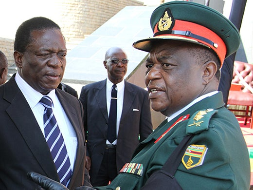 news_bMinister-of-Justice-Legal-and-Parliamentary-Affairs-Emmerson-Mnangagwa-Minister-of-Defence-Sydney-Sekeramayi-chat-to-Commander-Zimbabwe-Defence-Forces-Constantine-Chiwenga.jpg