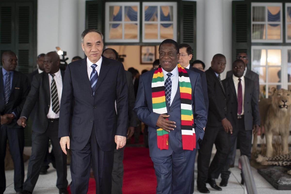 Zimbabwe's President Emmerson Mnangagwa (right) met China's special envoy Gu Shengzu (left) in Harare in September. Photo: AP