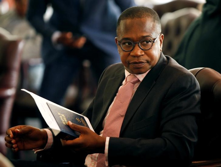 FILE PHOTO: Zimbabwean Finance Minister Mthuli Ncube looks on before the swearing in of new cabinet ministers at State House in Harare, Zimb