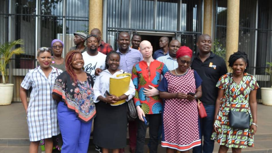 The seven activists, lawyer Jessie Majome (with yellow folder), family and friends outside Rotten Row Magistrates Court on January 8, 2020.