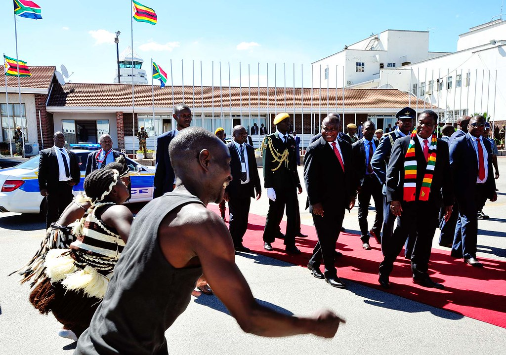 The Mashurugwi's activities have increased since Emmerson Mnangagwa (in scarf) became president. Credit: GCIS.