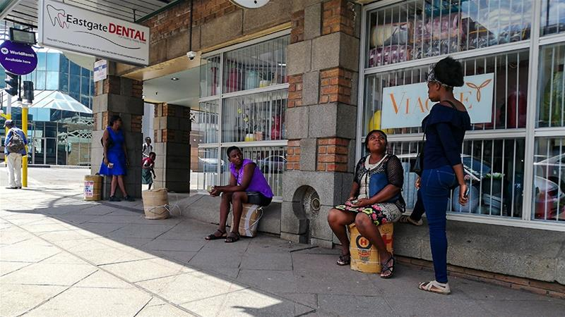 Illegal money traders who used to flood the streets of Harare and Mutare are now working from home while Zimbabwe is under lockdown to curb the spread of coronavirus [File: Farai Matiashe/Al Jazeera]