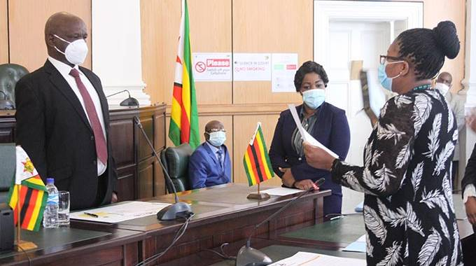 Eight sworn in as Judicial Service commissioners . . .