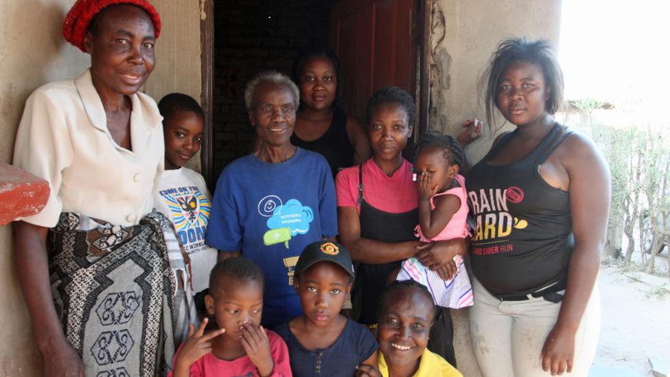 Grandmother Rudo Chinhoyi, in the blue t-shirt, surrounded by a few of her three children, nine grandchildren and eight great-grandchildren (Credit: Rachel Nuwer)