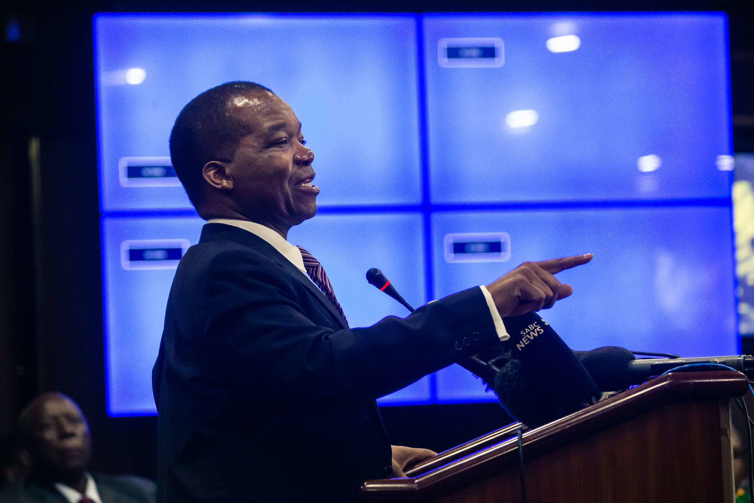 Zimbabwe Reserve Bank Governor John Mangudya delivers his Monetory Policy Statement in Harare on February 20, 2019, where he announced the establishment of an interbank foreign exchange market in the country officially abandoning the 1:1 exchange rate between the USD and the country's quasi currency the Bond note.