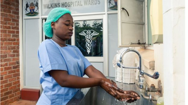 A medical staff member washes her hands at the Wilkins Infectious Diseases Hospital in Harare on March 11, 2020