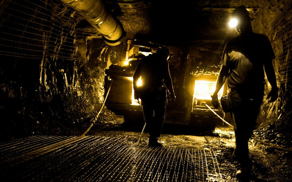 Two workers in an underground mine.