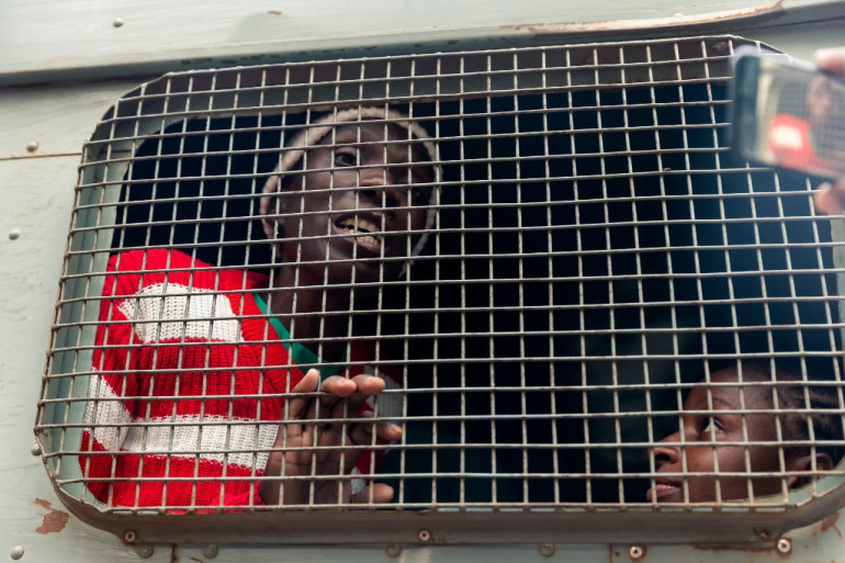 Critics say COVID-19 situation in prisons has been worsened by restrictions imposed by authorities [File: AFP]