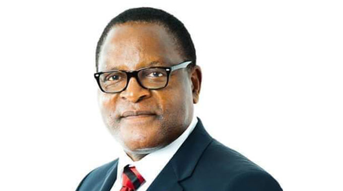 Malawi leader jets in