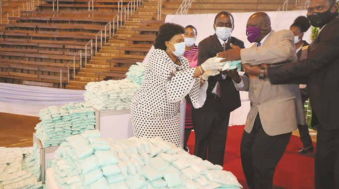 Women, girls hail First Lady's reusable pads project