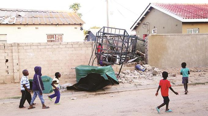 Water tank collapses, kills 2