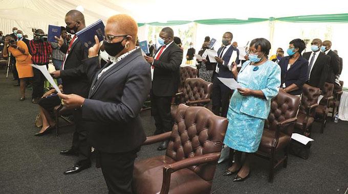 Members of 5 commissions sworn-in