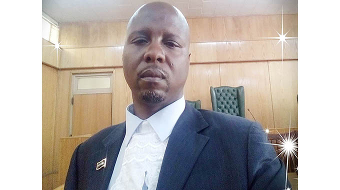 Armed robbers prosecutor on the run