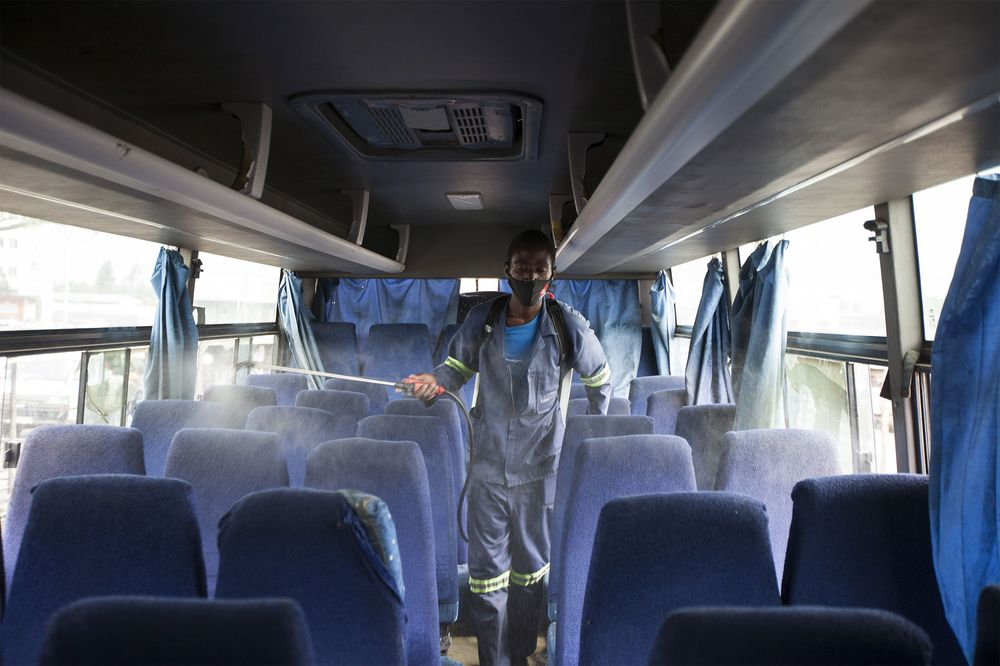 A worker disinfects abusin Harare, Zimbabwe on Dec. 31, 2020.