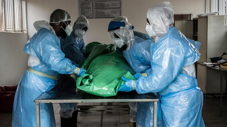 "Members of the Saaberie Chishty Burial Society prepare the body of a person who died from COVID-19 at a Johannesburg cemetary Saturday Dec. 26, 2020. South Africa's health minister has announced an ""alarming rate of spread"" in the country."