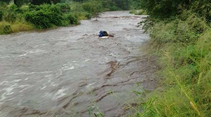 6 feared dead as car is swept by river