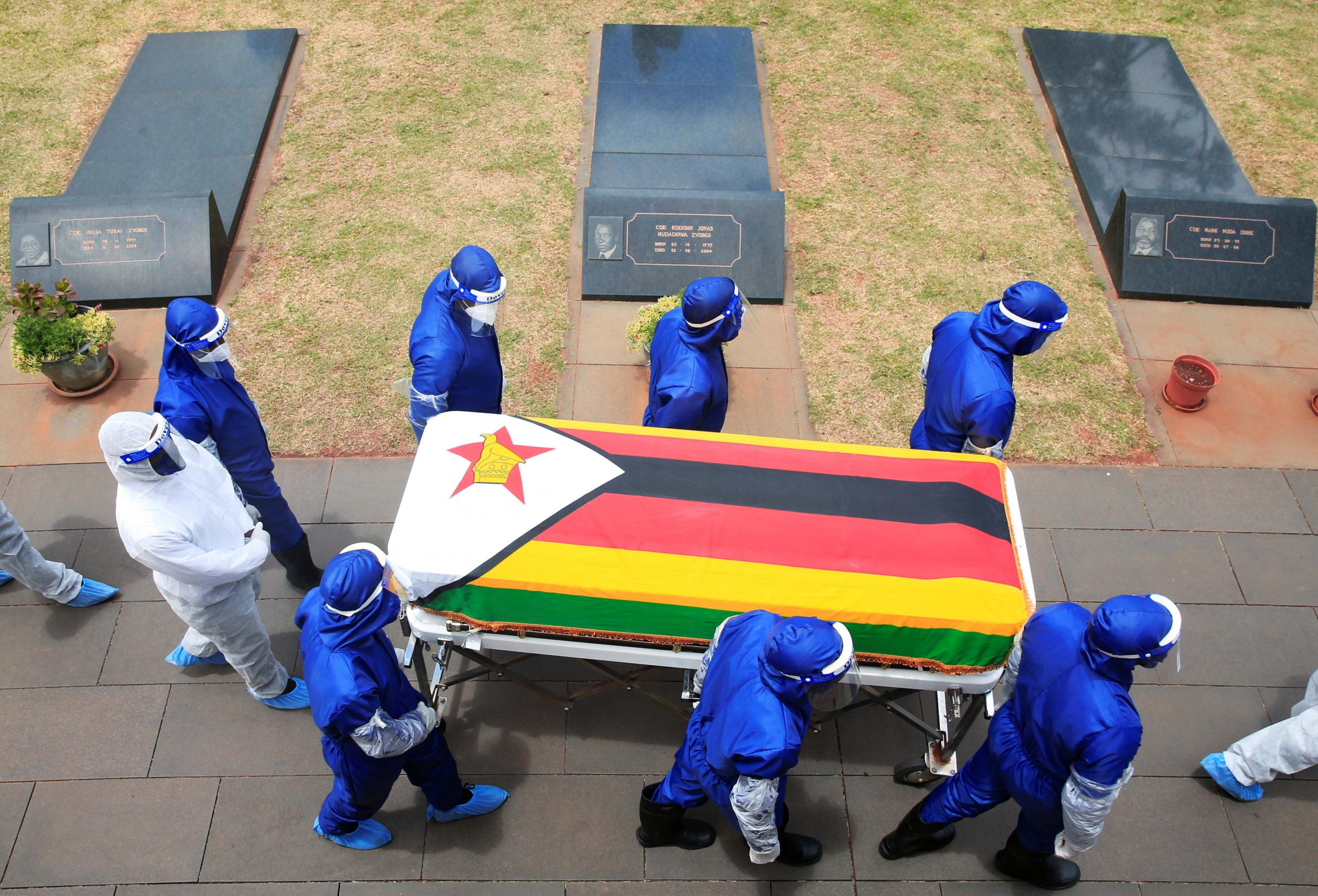 Pallbearers carry a coffin at the burial of two cabinet ministers and a retired general who died after contracting Covid-19 in Harare, Jan. 27.