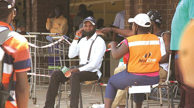 Money changers camp outside shops