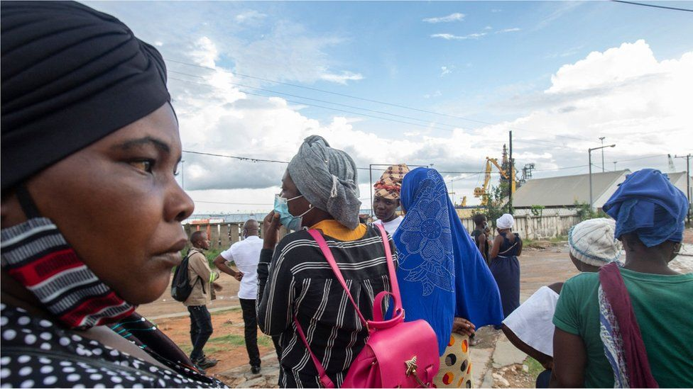People wait on the outskirts of the seaport of Pemba on March 30, 2021 for the possible arrival of their families evacuated from the coasts of Afungi and Palma after the attack by armed forces against the city of Palma on March 24, 202