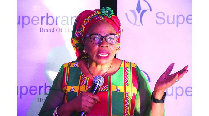 Women urged to aim higher