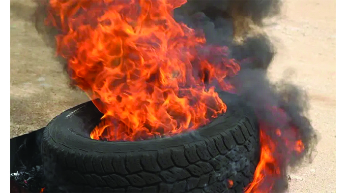 Guard beheaded, body burnt with tyres