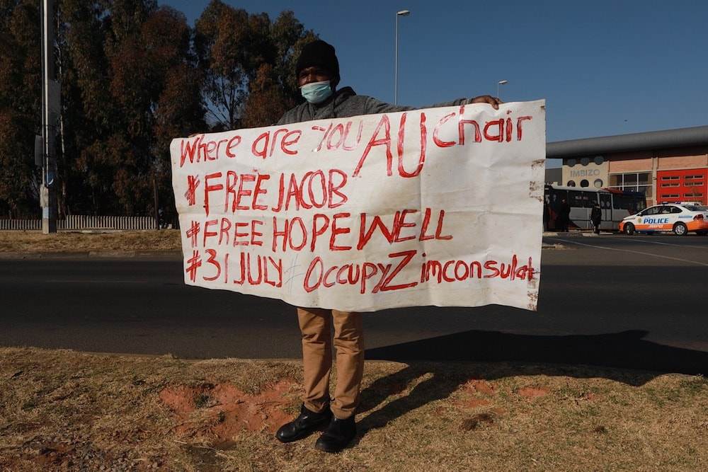 A Zimbabwean national protests the arrest of Zimbabwean journalists, in Soweto, South Africa, 29 July 2020, Fani Mahuntsi/Gallo Images via Getty Images
