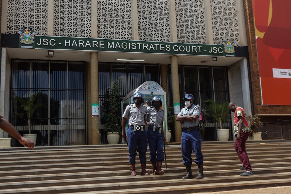 Police officers stand guard at the entrance to the Magistrate court in Harare, Zimbabwe, 6 April 2021, Tafadzwa Ufumeli/Getty Images