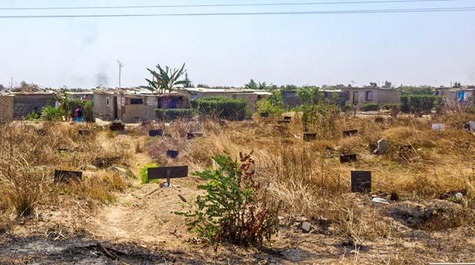 Land barons parcel stands in graveyard