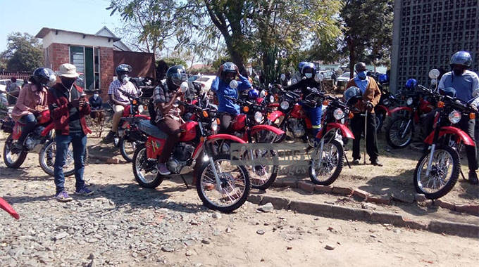 Agriculture extension workers receive motor bikes