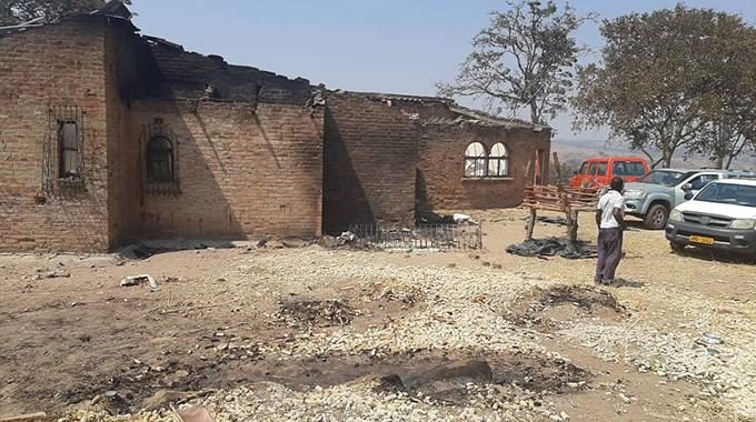 Two children killed as fire guts school