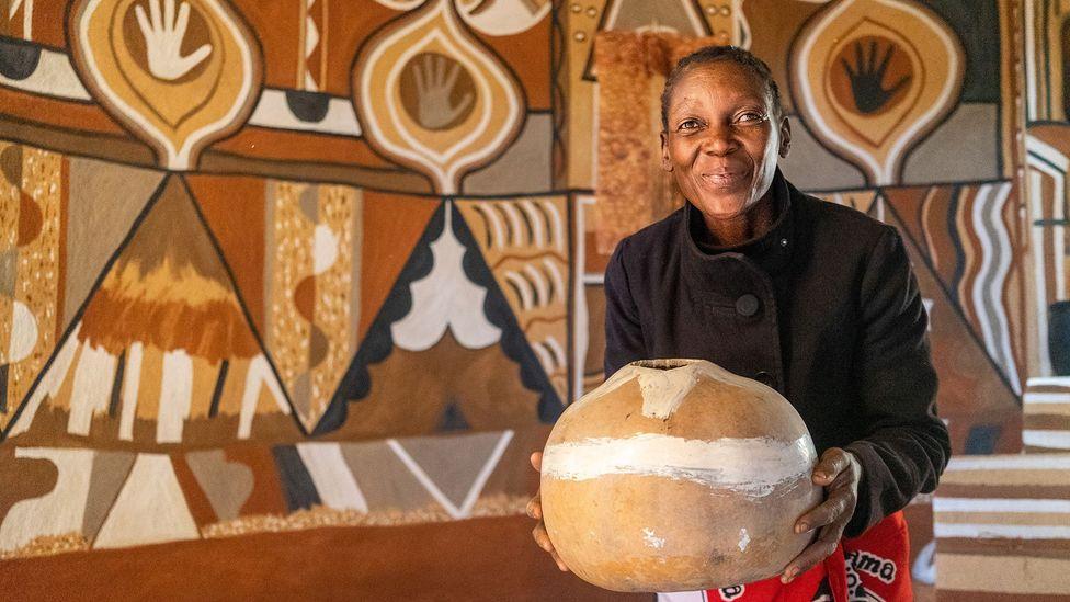 """I listen to the walls as I work and I feel like they tell me what sort of shape I must put,"" said Masuku (Credit: Zinyange Auntony)"
