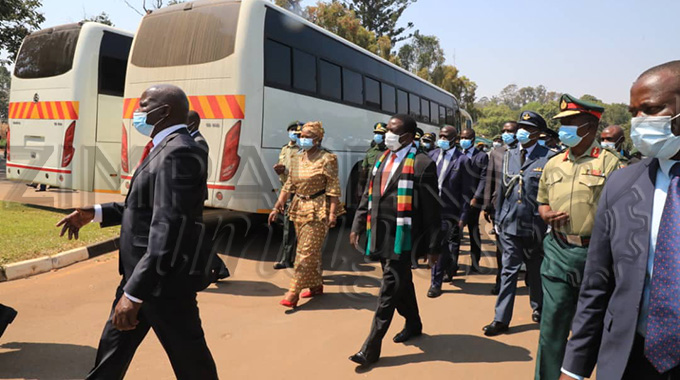 President hands over buses to security sector