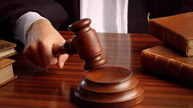 Legal clerk in court for filing false statement